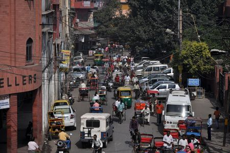 7737661-old-delhi-india--24-october-2009-traffic-jam-with-rickshaws-motorbikes-cars-and-pedestrians-on-local